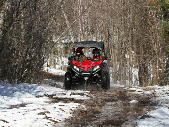 A person riding an ATV in winter