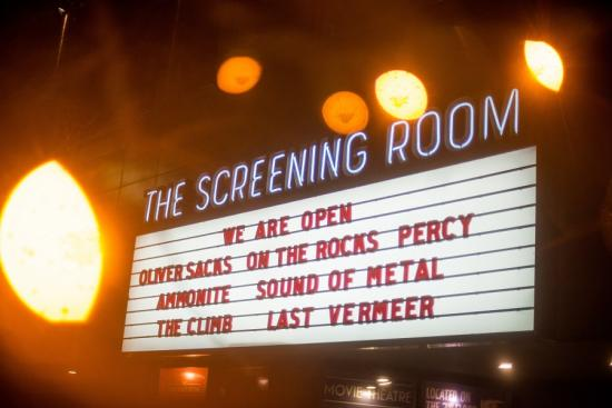Movie marquee board featuring in full display