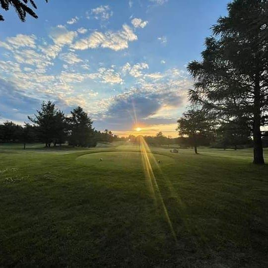 Blue skies as the sun is rising over the golf course