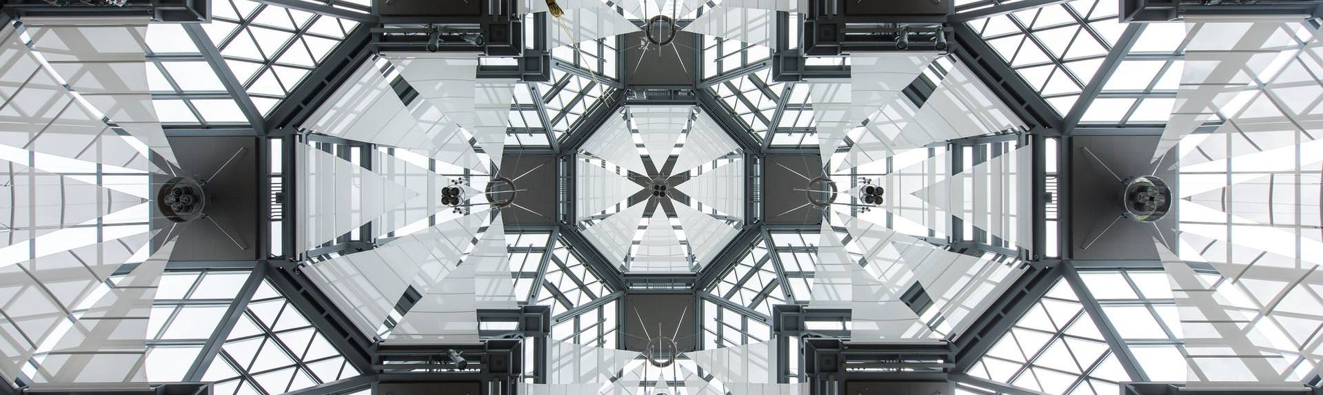 Ground level view of glass ceiling in a series of geometric shapes