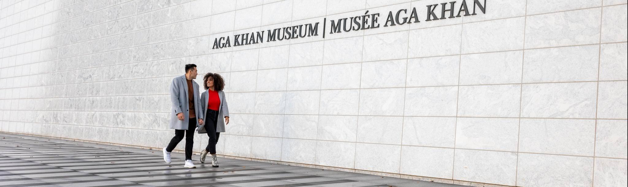 A couple walks outside the Aga Khan Museum