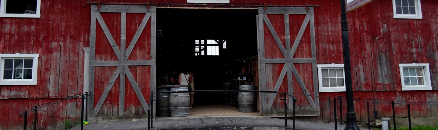 A rustic barn serves as a tasting room at a winery