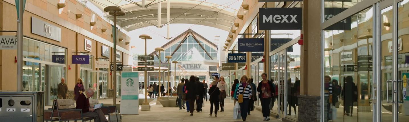 People walking through an airy shopping centre